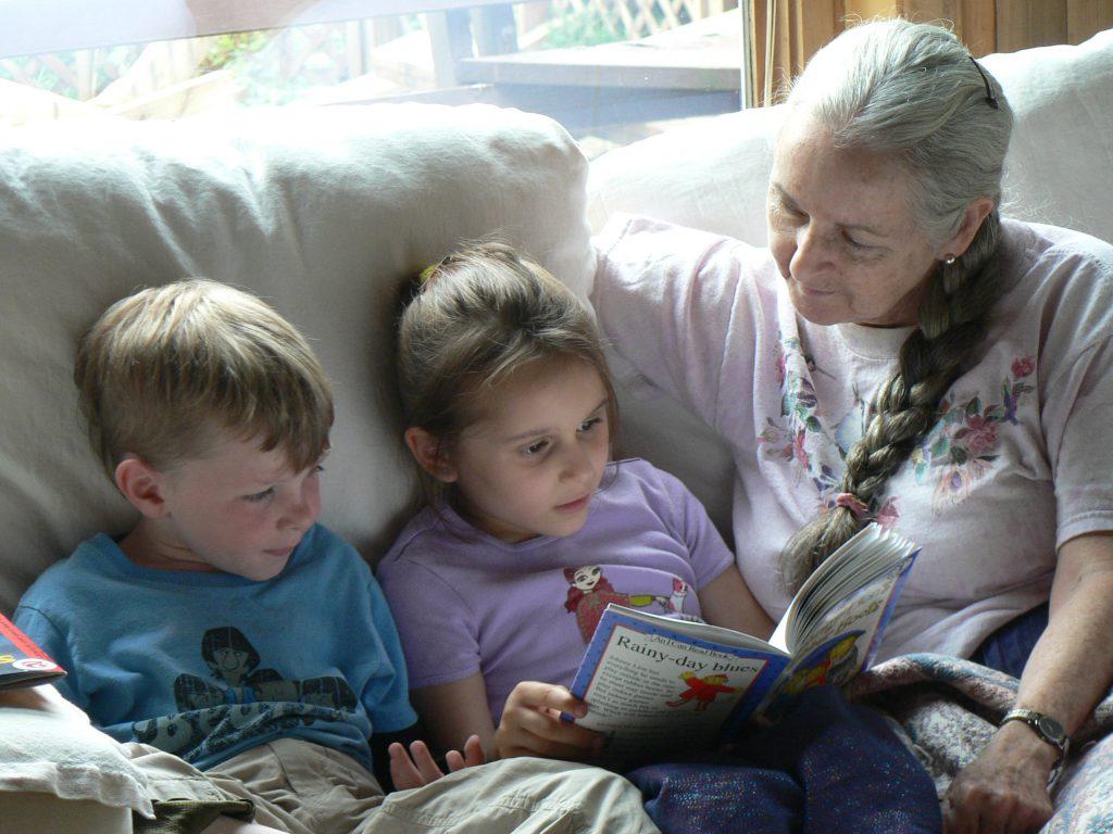 Students read to teacher at Sugarwood School