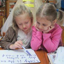 Children practice reading at Sugarwood School