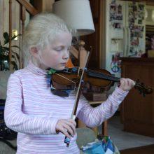 Child plays violin at Sugarwood School
